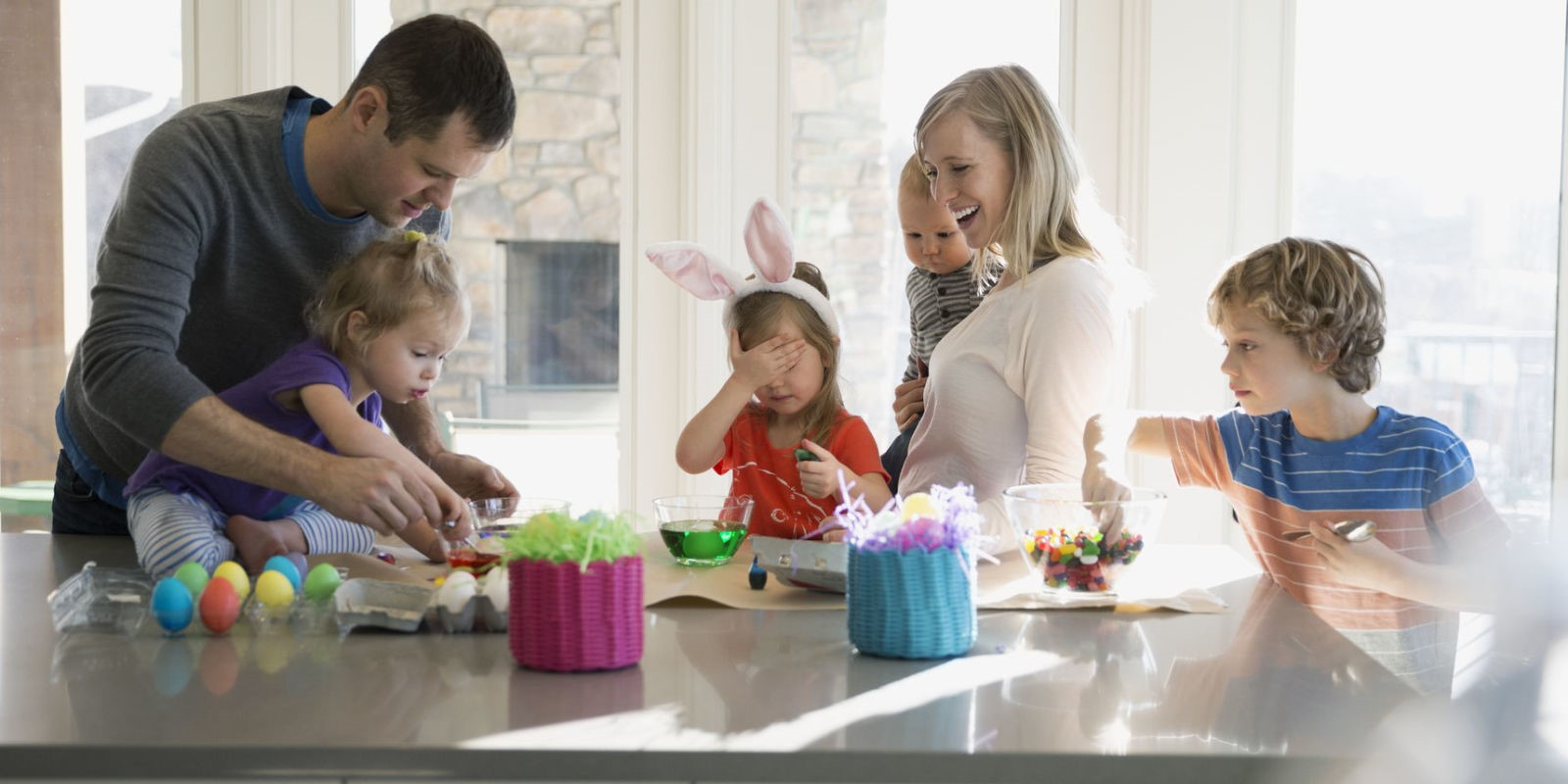 landscape-1492200950-family-colouring-easter-eggs-in-kitchen