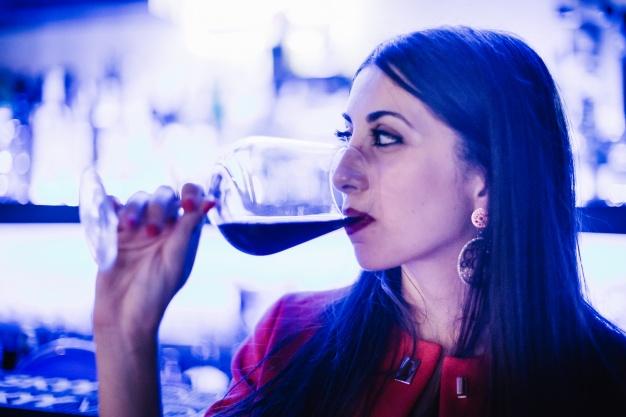 beautiful-woman-drinking-wine_23-2147670270