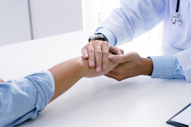 doctor-holding-patient-s-hand-and-reassuring-his-male-patient-helping-hand-concept_1715-1412