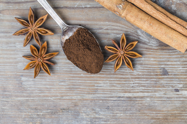 top-view-of-spoon-with-ground-coffee-and-aromatic-spices_1205-109