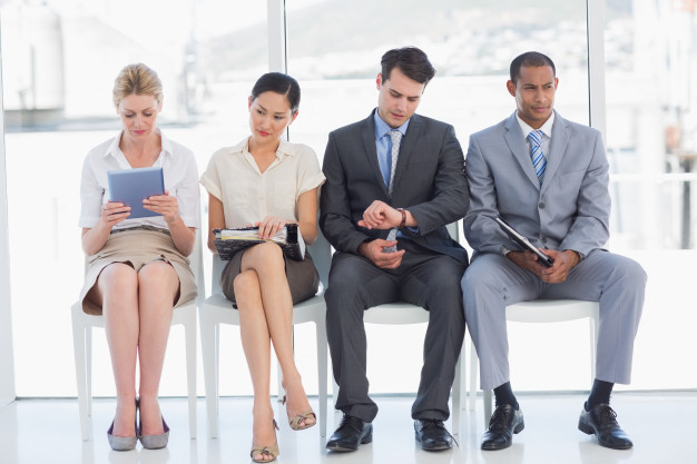 business-people-waiting-for-job-interview-in-office_13339-85453