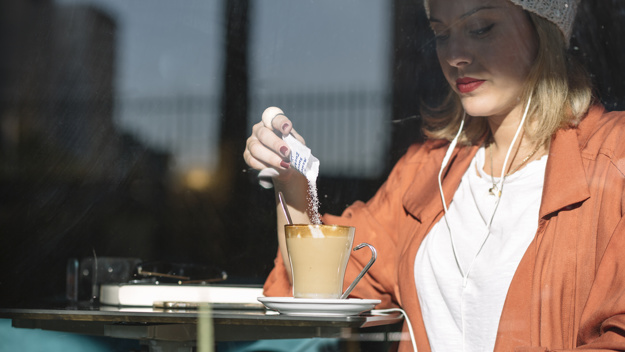woman-pouring-sugar-into-coffee_23-2147765328