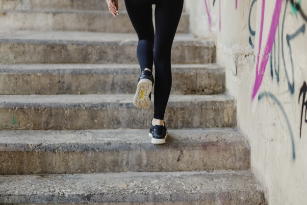 woman-running-up-stairs-outside_23-2147654902
