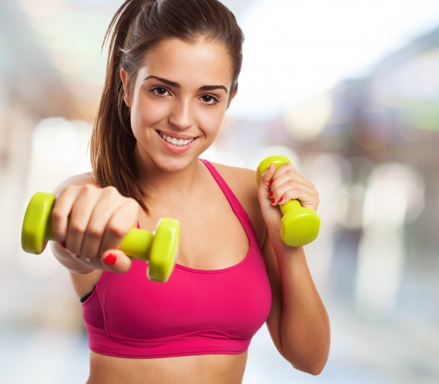 woman-with-dumbbells-in-a-shopping-center_1149-216