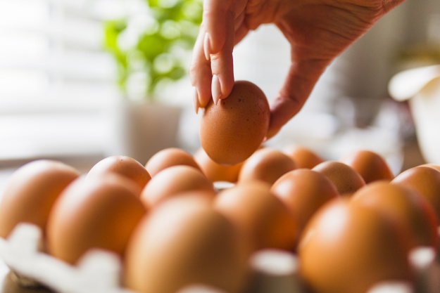 crop-hand-taking-eggs-from-carton_23-2147758344