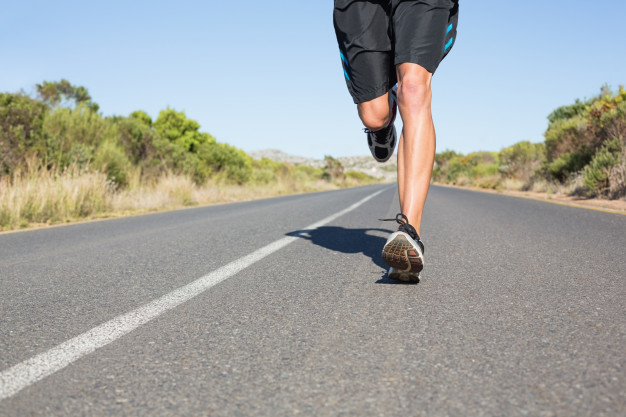fit-man-jogging-on-the-open-road_13339-45840