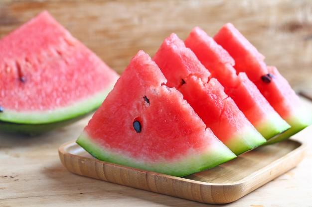 fresh-sliced-watermelon-on-wooden-background_1387-391