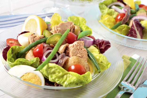 Nicioise salad arranged on table