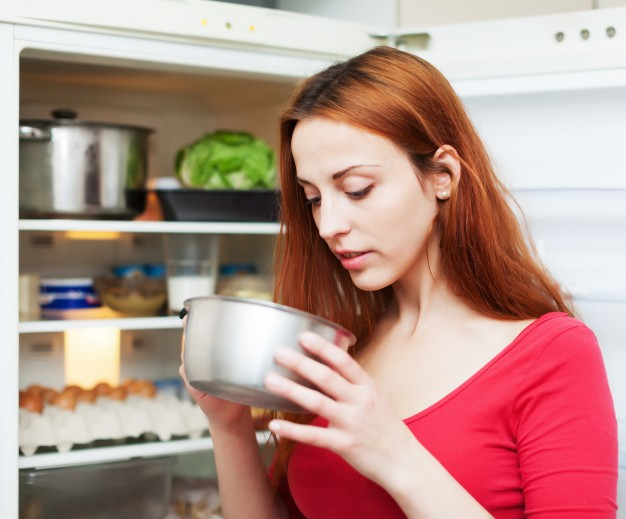 woman-looking-for-something-in-pan-near-fridge_1398-1891
