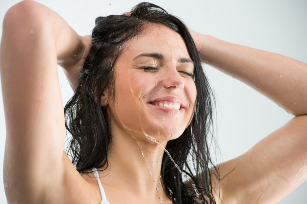 woman-showering-with-happy-smile-and-water-splashing_19485-2043