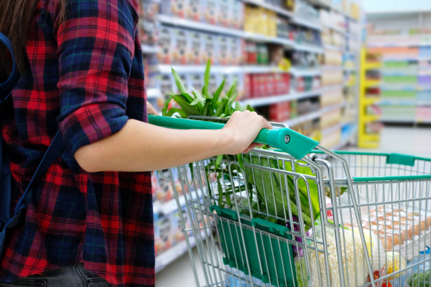 woman-with-shopping-cart-purchasing-food-in-a-supermarket_45990-13