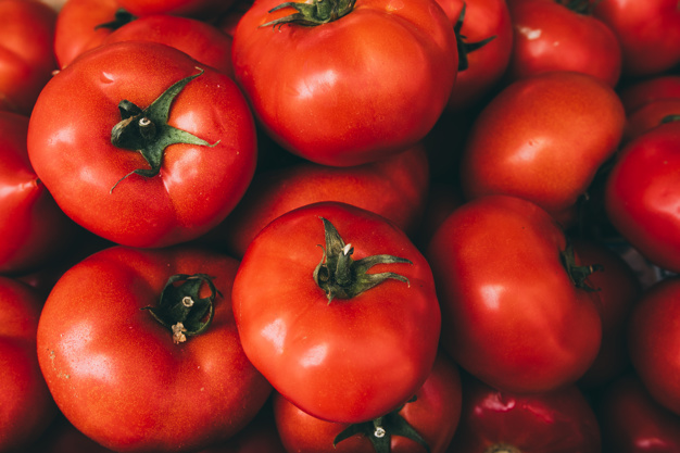 pile-of-delicious-tomatoes_23-2147828821