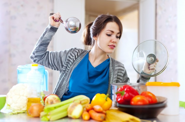woman-cooking-veggie-lunch-with-laddle_1398-347