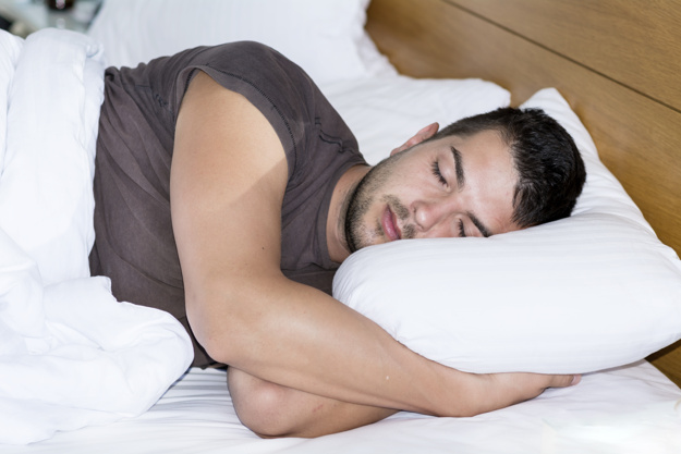 young-man-sleeping-in-his-bed_1169-149