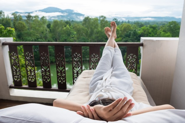 young-woman-relax-on-bed-and-enjoying-mountain-view_1423-235