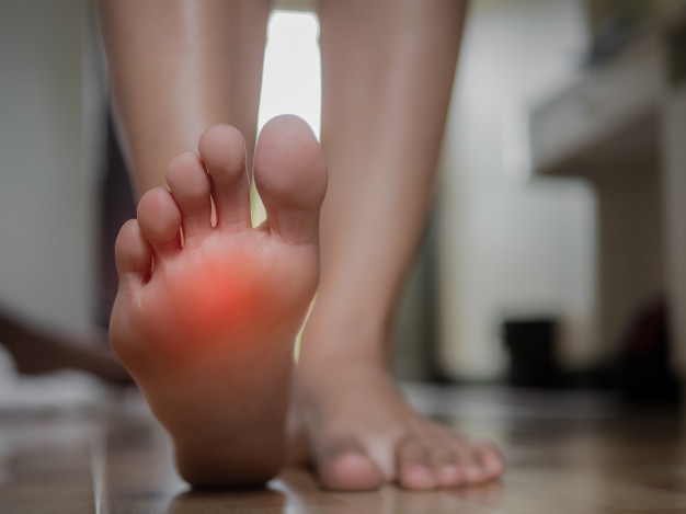 closeup-female-foot-pain-health-care-concept_53476-47
