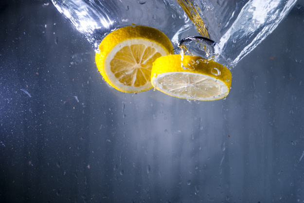 water-background-with-two-lemon-slices_23-2147608415