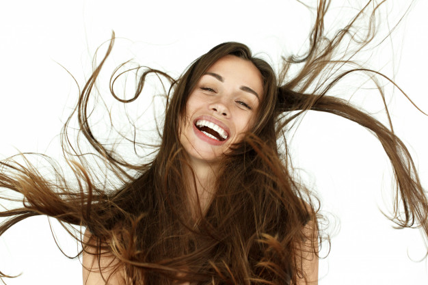 beautiful-woman-shakes-her-hair-on-white-background_8353-1698