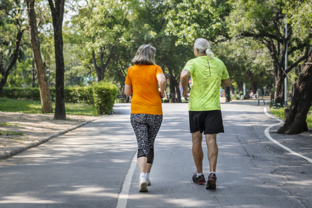 Couple running together in a race