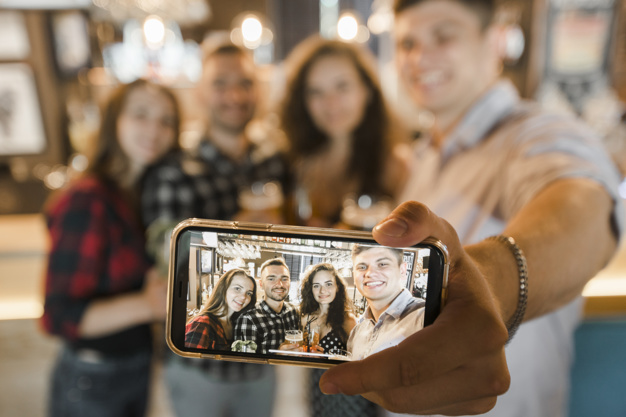 group-of-happy-friends-taking-selfie-on-cellphone_23-2147859575