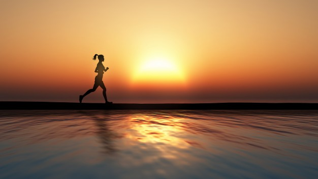 person-running-on-the-beach-sunset_1048-4498