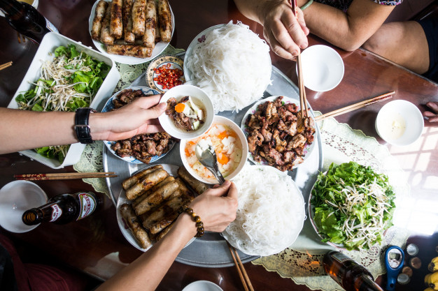 feasting-with-family-on-vietnamese-traditional-food_449-19325643