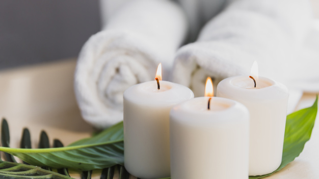 candles-and-leaves-near-towels_23-2147809180