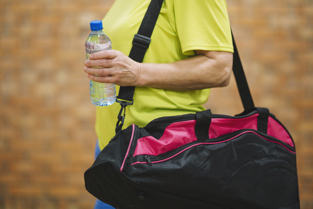 side-view-of-woman-with-sports-bag_23-2147776943