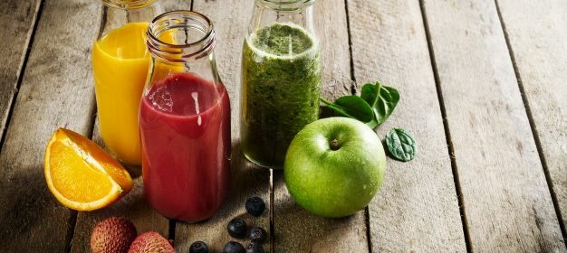 tasty-colorful-fresh-homemade-smoothies-in-glass-jars-on-wooden-table-healthy-detox-concept_1220-1121