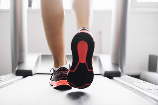 woman-in-sports-shoes-running-on-treadmill_23-2147688019