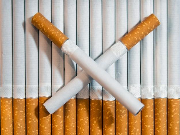 cigarette-close-up-isolated-on-white-background-drug-addiction-tobacco-smoking-cancer-nicotine-bad-habit-ashtray-quit-smoking_1391-110