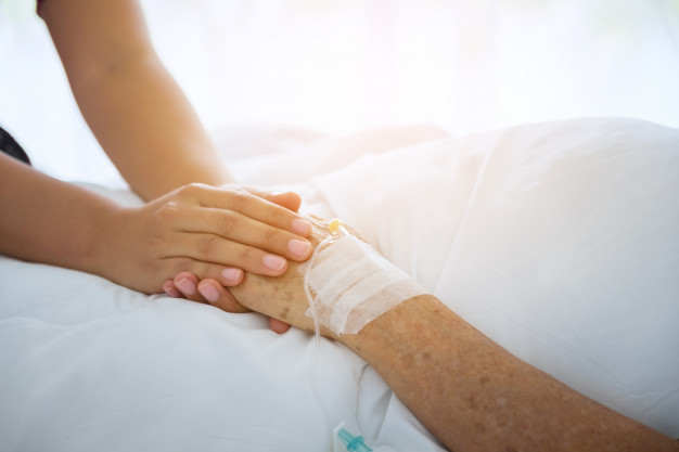 medical-doctor-holing-senior-patient-s-hands-and-comforting-her_28914-476