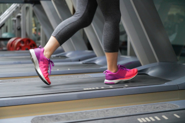close-up-on-woman-leg-running-on-treadmill-after-her-work_31825-21