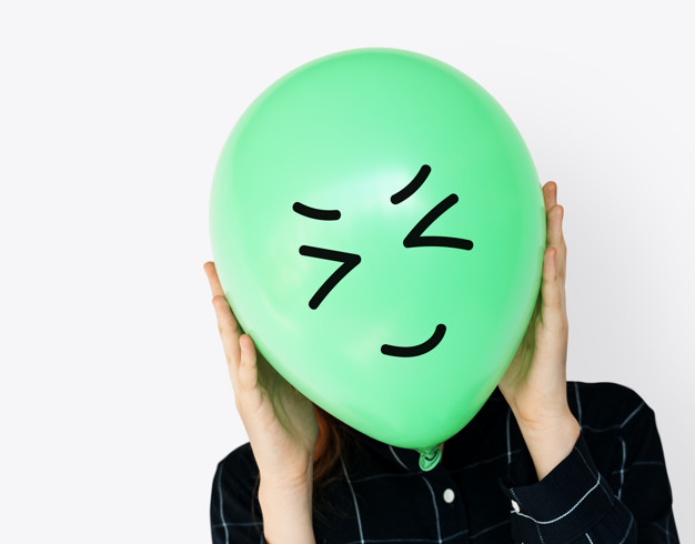 People Faces Covered with Happy Expression Emotion Balloons