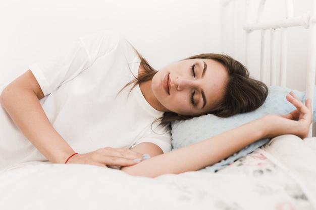 pretty-woman-sleeping-on-bed_23-2147848978