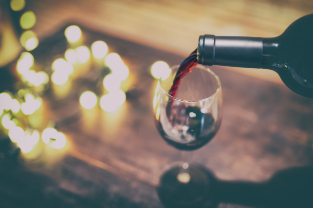 red-wine-pouring-into-wine-glass_49229-51