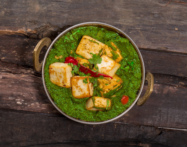 indian-punjabi-cuisine-palak-paneer-made-up-spinach-cottage-cheese-decorative-kadhai_57665-25